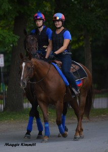 Alice Clapham on Miss Temple City heading to the track at Saratoga with Mary Motion on Lance